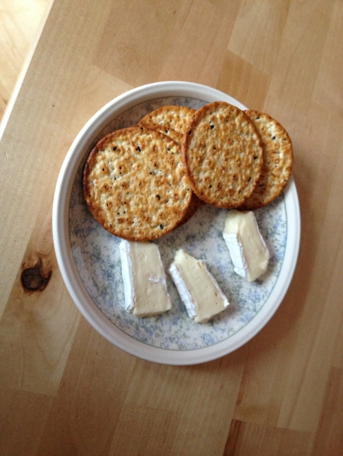 My snack last night. Brie and crackers. Delicious!